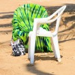 Foto Stock: Chairs on beach in tropics