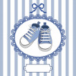 Blue baby shoes and frame — Stock Vector #9100707