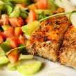Salmon on salad — Stock Photo
