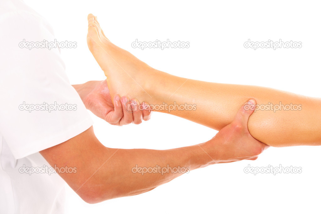 A picture of a physio therapist giving a leg massage over white background — Stock Photo #9533932