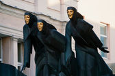 Three Graces on the roof of the dramatic theater. Vilnius. Lithu — Stock Photo