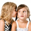 Two little girls whispering isolated over white — Stock Photo