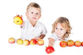 Two kids offer apples isolated on white background — Stock Photo