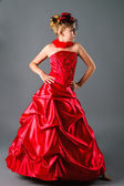 Teen girl posing in prom dress on studio neutral background — Stock Photo