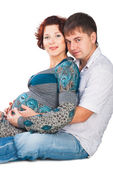Portrait of a happy young pregnant woman with her husband — Stock Photo