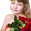 Adorable girl with bouquet of red roses isolated over white back — Stock Photo