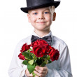 Handsome boy in classic suit with flowers isolated on white back — Stock Photo