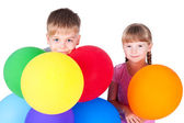 Boy and girl 6 years old with colorful balloons isolated on whit — Stock Photo