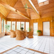 Wooden Wall Sun Room Interior with Wicker Furniture — Stock Photo #8137852