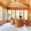 Wooden Wall Sun Room Interior with Wicker Furniture — Stock Photo #8137857
