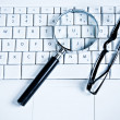 Magnify Glasses on Keyboard — Stock Photo