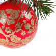 Red Christmast Ball on Pine Branch - Stock Photo