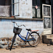 Bike and old house — Stock Photo