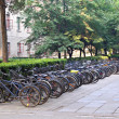 Row of bikes parked behind apartment building — Stock Photo