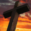 Rustic Wooden Cross Against Sunset — Stock Photo #8138220