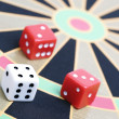 Stock Photo: Dice on game board