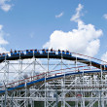 Theme park roller coaster — Stock Photo #8138744