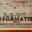 Information Sign on Brick Wall — Stock Photo