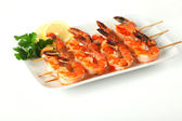 Shrimp skewers with sweet garlic chili sauce on isolated backgro — Stock Photo