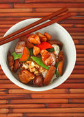 Bowl of Stewed Chicken over White Rice — Stock Photo