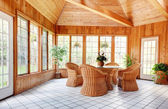 Wooden Wall Sun Room Interior with Wicker Furniture — Stock Photo