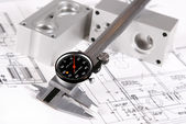 Rustic caliper on mechanic blue prints — Stock Photo