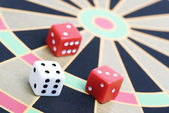 Dice on game board — Stock Photo