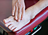 Senior patient foot on examination bench — Stock Photo