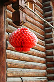 Red lantern outside the wooden cabin — Stock Photo