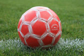 Weathered Soccer Ball on the Field — Stock Photo