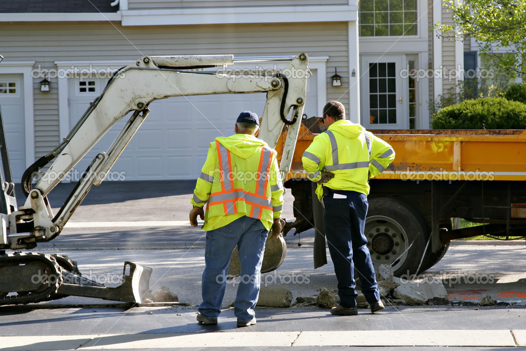 Construction workers working on residential street — Stock Photo #8138978