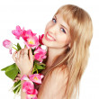 Picture of happy young blonde woman with colorful flowers — Stock Photo