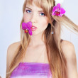 Beautiful girl with pink flowers — Stock Photo