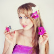 Beautiful girl with pink flowers — Stock Photo #10296508