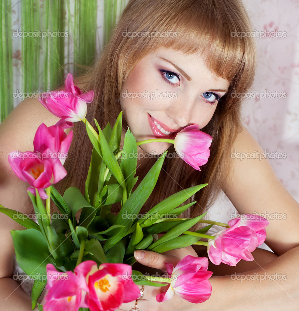 Series. Picture of happy young blonde woman with colorful flowers — Stock Photo #10296371