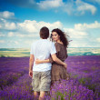 Young beautiful girl and man in lavender field — Stockfoto