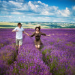 Young beautiful girl and man in lavender field — Stock Photo