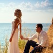 Stock Photo: Young pair wedding. Walk at mountains near the sea
