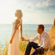 Young pair wedding. Walk at mountains near the sea — Stock Photo