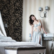 Young girl in a silver dress resting in a hotel — 图库照片 #8076256
