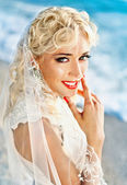 Portrait of the young beautiful blonde with brightly red lips — Stock Photo