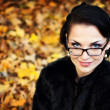 Portrait of the young business woman in autumn park — Stock Photo #8168827