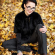 Portrait of the young business woman in autumn park — Stock Photo #8168845