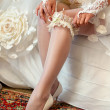 Beautiful leg of the young bride — Stock Photo