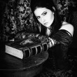 Stock Photo: Portrait of girl in Gothic style with book in hands