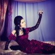 Portrait of girl in Gothic style on beautiful bed — Stock Photo #9092430