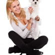 Happy girl and white dog — Stock Photo