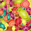 Seamless pattern -  sweet candy on  colored  background — Stock Vector