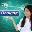 Woman with booking button — Stock Photo