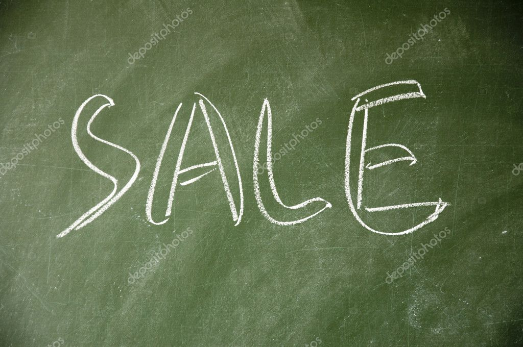 Sale title written with chalk on blackboard — Stock Photo #8593605